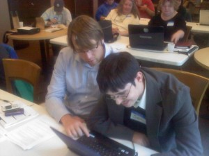 WeCo Certified Test Consultant, Sam, working with his job coach, Tim.