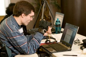 Our Tester Chad uses a pointer to access the internet with his laptop