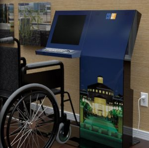 A wheel chair pulled up in front of a kiosk designed for accessibility.