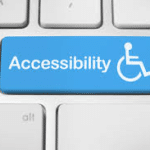 """Web Accessibility - Computer keyboard with a blue key and the word """"Accessibility"""" with a disability wheel chair symbol."""