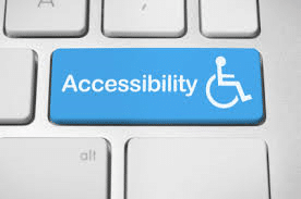 "Accessible websites - Computer keyboard with a blue key and the word ""Accessibility"" with a disability wheel chair symbol."