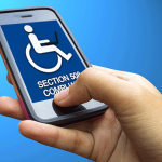 "A person holding a smartphone with the symbol of a person in a wheel chair on the screen and the words ""Section 508"" beneath it."