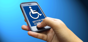 Hand holding a cell phone with a handicap symbol on it with the words Section 508 compliance