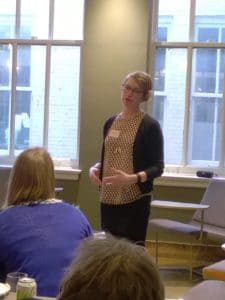 A MeetUp member giving a talk in front of a group.