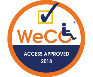 "WeCo's trademark certified Access Approved logo.  An orange circle with the WeCo logo and a checkmark above it.  The words, ""Access Approved 2018"" are below the logo."