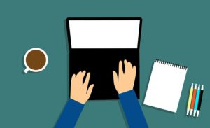 Illustration of hands on a lap top keyboard. The desk also has a notebook and a coffee cup on it.
