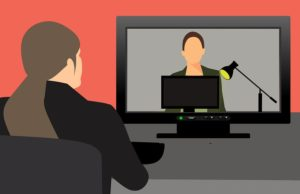 Illustration of a woman seated at a desk watching someone give a webinar on her computer screen.