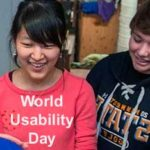 A girls in a pink shirt and boy in black shirt smiling. This is a snippet of the U of MN WUD event logo.