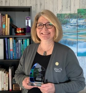 Debbie Heilig, Director of WeCo Customer Relations, holding the 2020 NOD Leading Disability Award